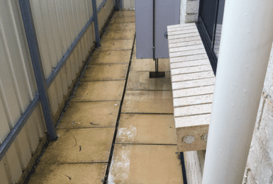 Tip: Ensure that all areas have adequate drainage. Poor drainage (pictured) can result in Slab Edge Dampness.